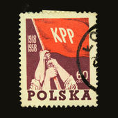 A stamp printed in Poland shows three hands with banner of Communist party of Poland, circa 1958 — Stock Photo