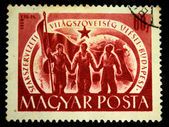 : A Stamp printed in Hungary shows three men with red banner, circa 1958 — Photo