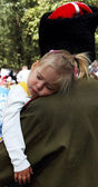Little girl sleeping on the shoulder of his father, the Cossack — Stock Photo