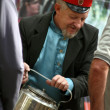 Cossack pours tefrom old kettle — Stock Photo #13280815