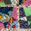 Hand made crazy quilt - Stock Photo
