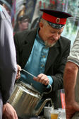 Cossack pours tea from an old kettle — Foto Stock