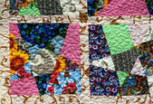 Hand made crazy quilt — Stock Photo