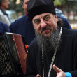 Stock Photo: Orthodox priest speack with Don Cossack