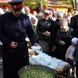 Постер, плакат: Don Cossack gives gruel to treat parishioners