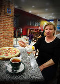 Woman at Cafe Eating Pizza — Стоковое фото