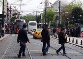 Three men crossing the road near — Stock Photo