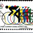 Stock Photo: Bicycling and Olympic Rings