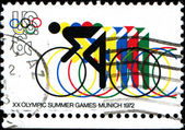 Bicycling and Olympic Rings — Stock Photo