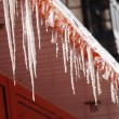 Stock Photo: Icicles on roof.