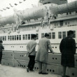 Three men and boy considering passenger ship — стоковое фото #40075003