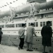 Стоковое фото: Three men and boy considering passenger ship