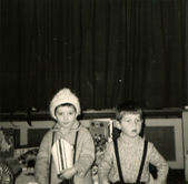 Little boy and girl standing in front of the stage — Stock Photo