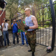 Постер, плакат: Pro russian insurgents removed Ukranian coat of arms