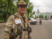 Armed man in Luhasnsk — Stock Photo