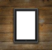 Tableta digital sobre un fondo de madera — Foto de Stock