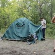 Stock Video: Two men removed a tent