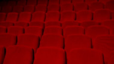 Empty auditorium - red chairs in rows — Stockvideo
