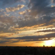 Sunset over city, aerial view, timelapse — Stock Video #12731202