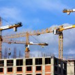 Stock Photo: Working construction cranes