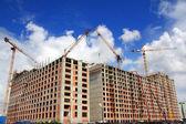 Working construction cranes — Stock Photo