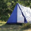 Camping - tent in forest - Stock Photo