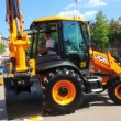 Demonstration of multifunctional tractor at the exhibition — Stok video