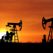 Working oil pumps silhouette against timelapse sunrise — Vidéo