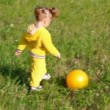 Little girl with ball on meadow — Stock Video