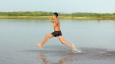 Boy jumping in lake - summer vacations — Stock Video
