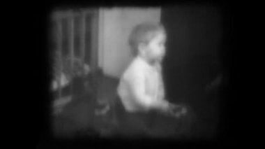 Old family movie shown on a film projector — Stockvideo
