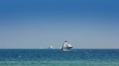 Yachts and surfers on turquoise sea — Stock Video