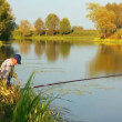 Fishing senior couple on autumn lake - timelapse - Stock Photo