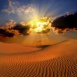 Dramatic suset landscape in desert — Stock Photo #23485153