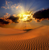 Dramatic suset landscape in desert — Stock Photo