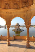 Old jain cenotaphs on lake in jaisalmer india — Stock Photo