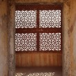 Ornament lattice window in india - Stock Photo