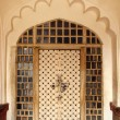 Stock Photo: Ornamental door in India