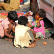 Poor indian chidren on town street — Stock Photo