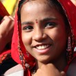 Portrait of Indian girl Pushkar camel fair — Stock Photo #27782117