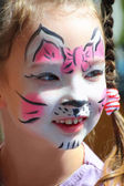 Cute dziewczynka z kotów makijaż — Zdjęcie stockowe