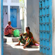 Two Indian women are working outside his home — Stock Photo