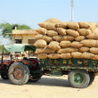 Stock Photo: Tractor loaded with bags in india