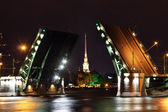 Open drawbridge at night in St. Petersburg — Stock Photo
