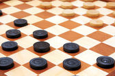 Checkerboard with checkers spaced — Stock Photo