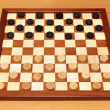 Stock Photo: Checkerboard with checkers spaced