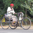 Old indian man on bike with manual drive — Stock Photo