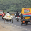Variety of vehicles on indian road — Stock Photo