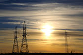 Electric masts at sunset — Stock Photo