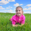 Happy little girl lying on grass — Foto Stock